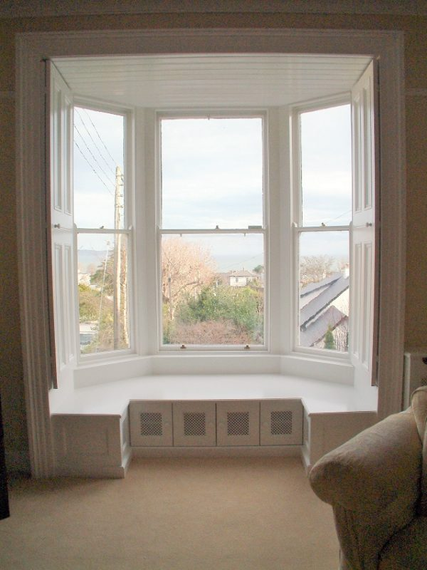 Interior restoration of a period bay window and shutters by Impressions Painters and decorators in Dalkey
