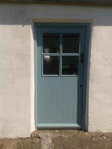 A painted and finished door by Impressions Painters and Decorators using Colortrend