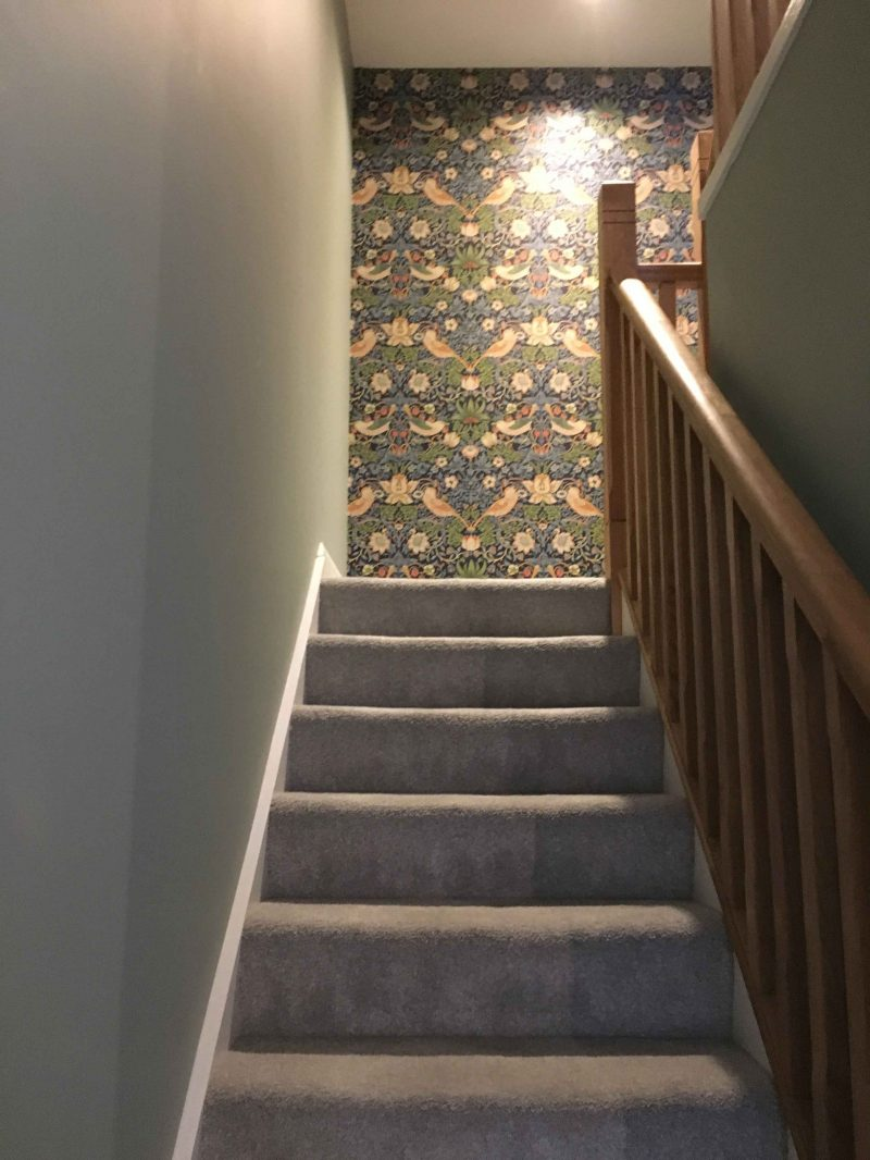 Example of wallpering a landing on a staircase as a feature wall by Impressions Painting and Decorating