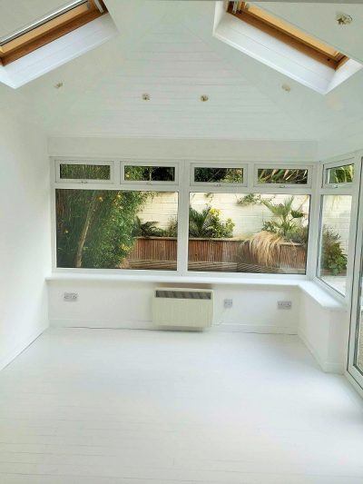 PaiWooden ceiling and floor painted all white by Impressions Painting and Decorating in Co Wicklownting a kitchen white by Impressions Painting and Decorating in Co Wicklow