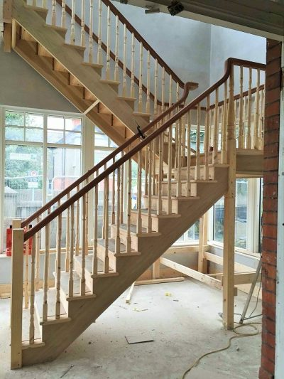 Before photo - how to paint a newly built staircase - start with primer