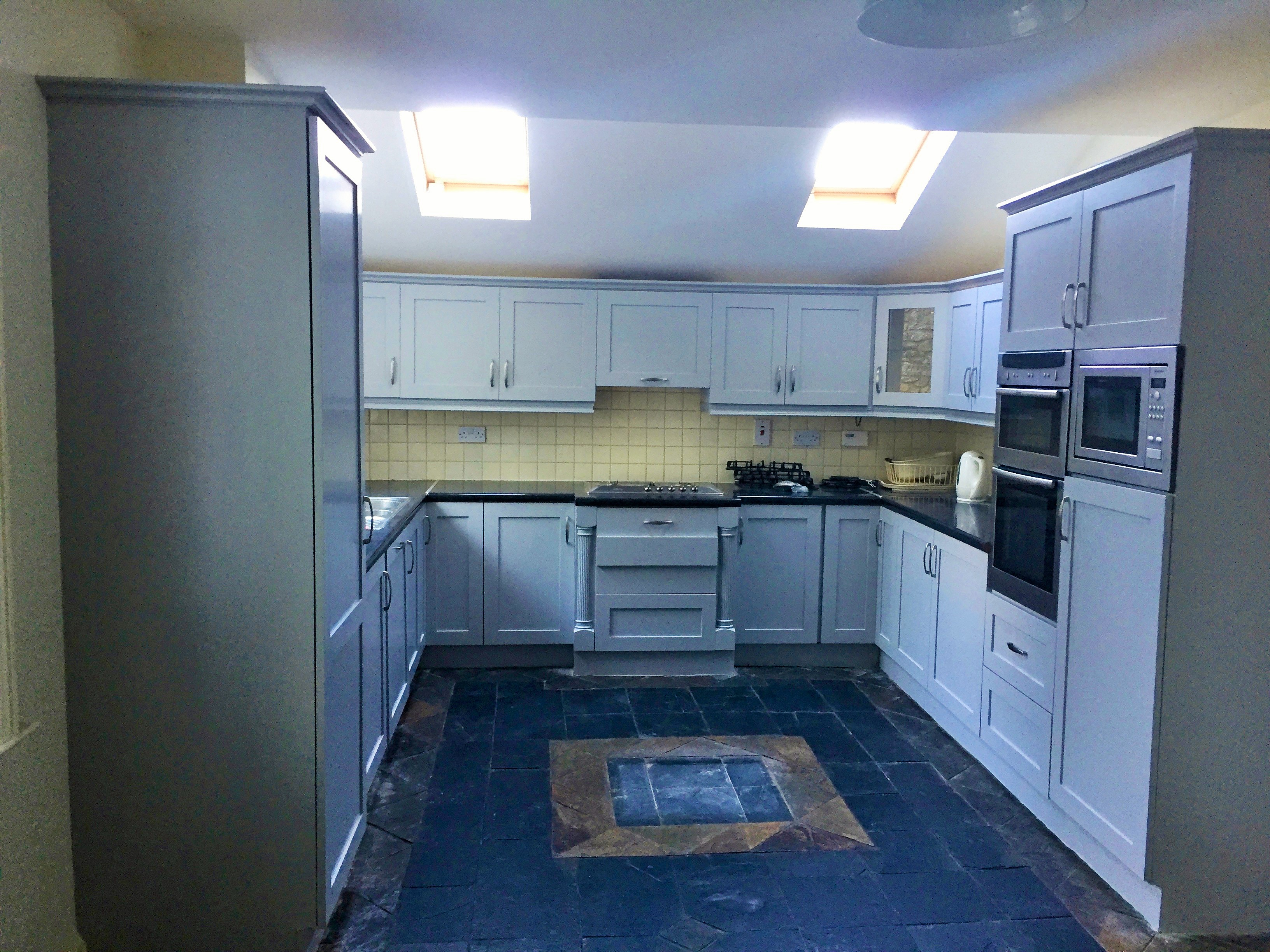 How to paint a laminated surfaces - after photo of a laminated kitchen we painted in Sandycove by Impressions Painting and Decorating