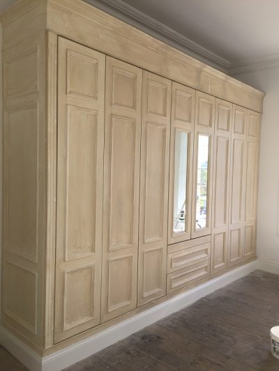Before example of a caulked wardrobe - How to caulk and fill a new wardrobe by Impressions Painting and Decorating