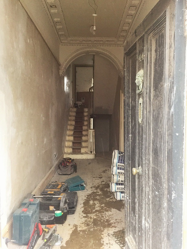A hall, stairs, landing and period door in Ranelagh before being painted by Impressions Painting and Decorators