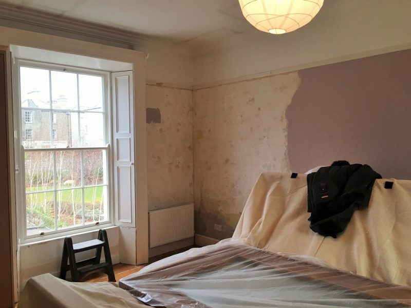 Before photo of a master bedroom in a period house that was wallpapered and redecorated by Impressions Painting and Decorating