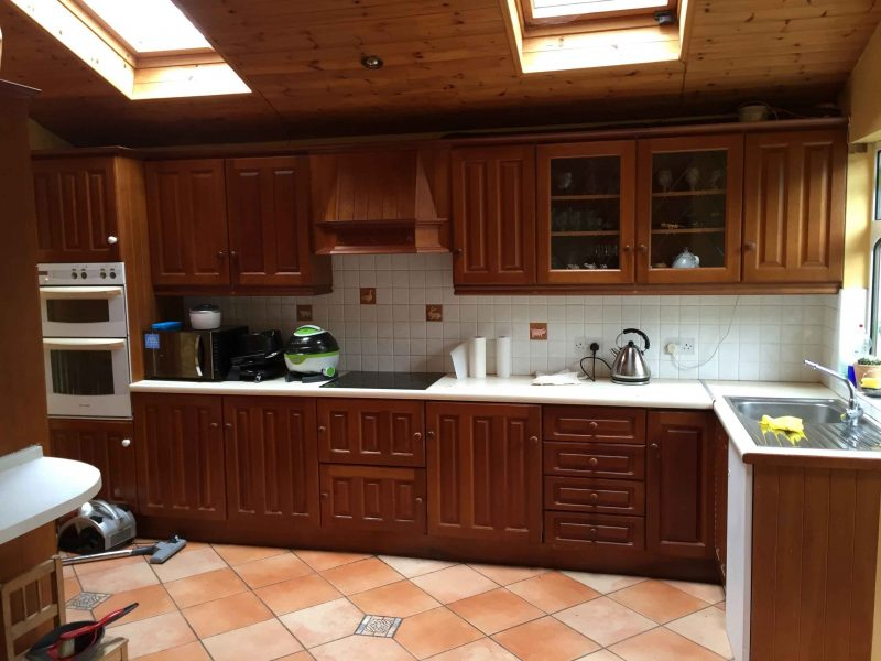 Before photo of a wooden, hand-painted kitchen by Impressions Painters and Decorators in Dundrum