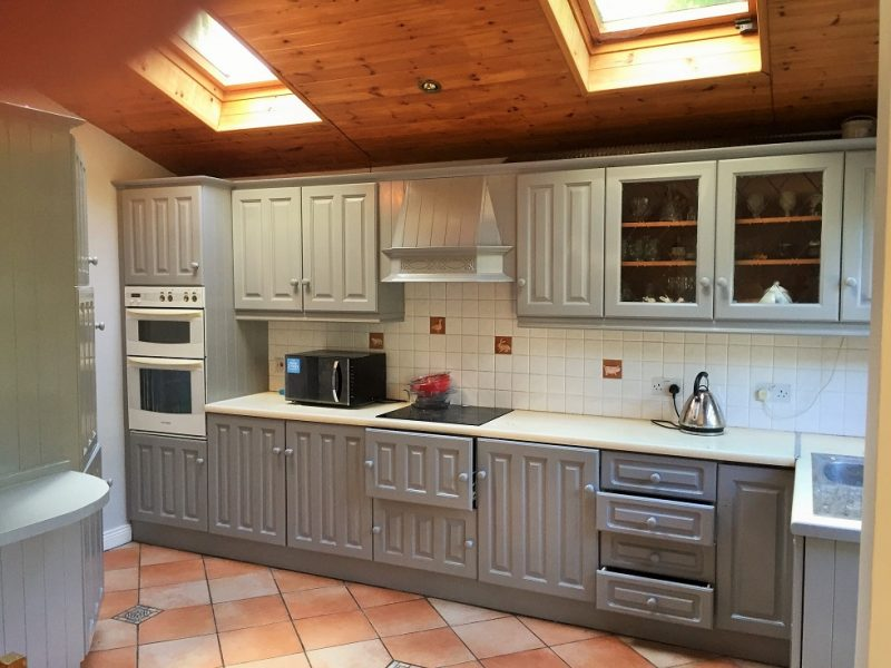 Kitchen after being hand painted painted by Impressions Painting and Decorating in Dundrum
