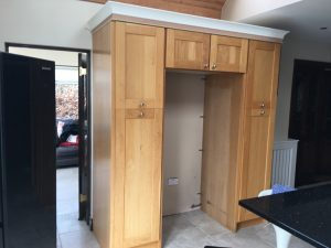 Before photo of a hand-painted kitchen unit in Co. Meath by Impressions Painting and Decorating