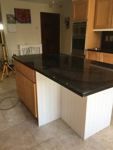 Before photo of an island unit in a kitchen in Co. Meath by Impressions Painting and Decorating