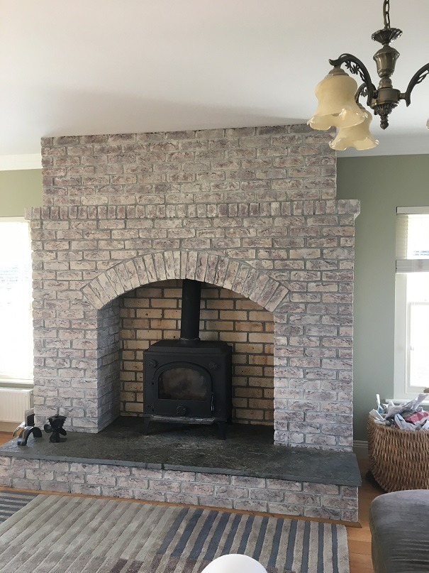 How to whitewash brick - A brick fireplace after being whitewashed