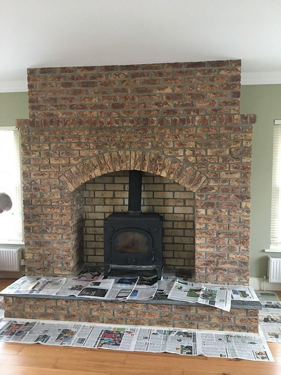 How to whitewash brick - A brick fireplace before being whitewashed