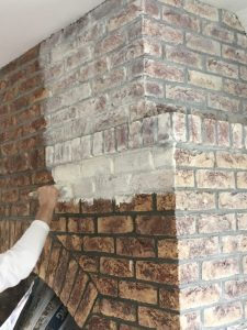 How to whitewash brick - A brick fireplace whilst being whitewashed