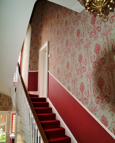 A wallpapered staircase in Dublin by Impressions Painting and Decorating