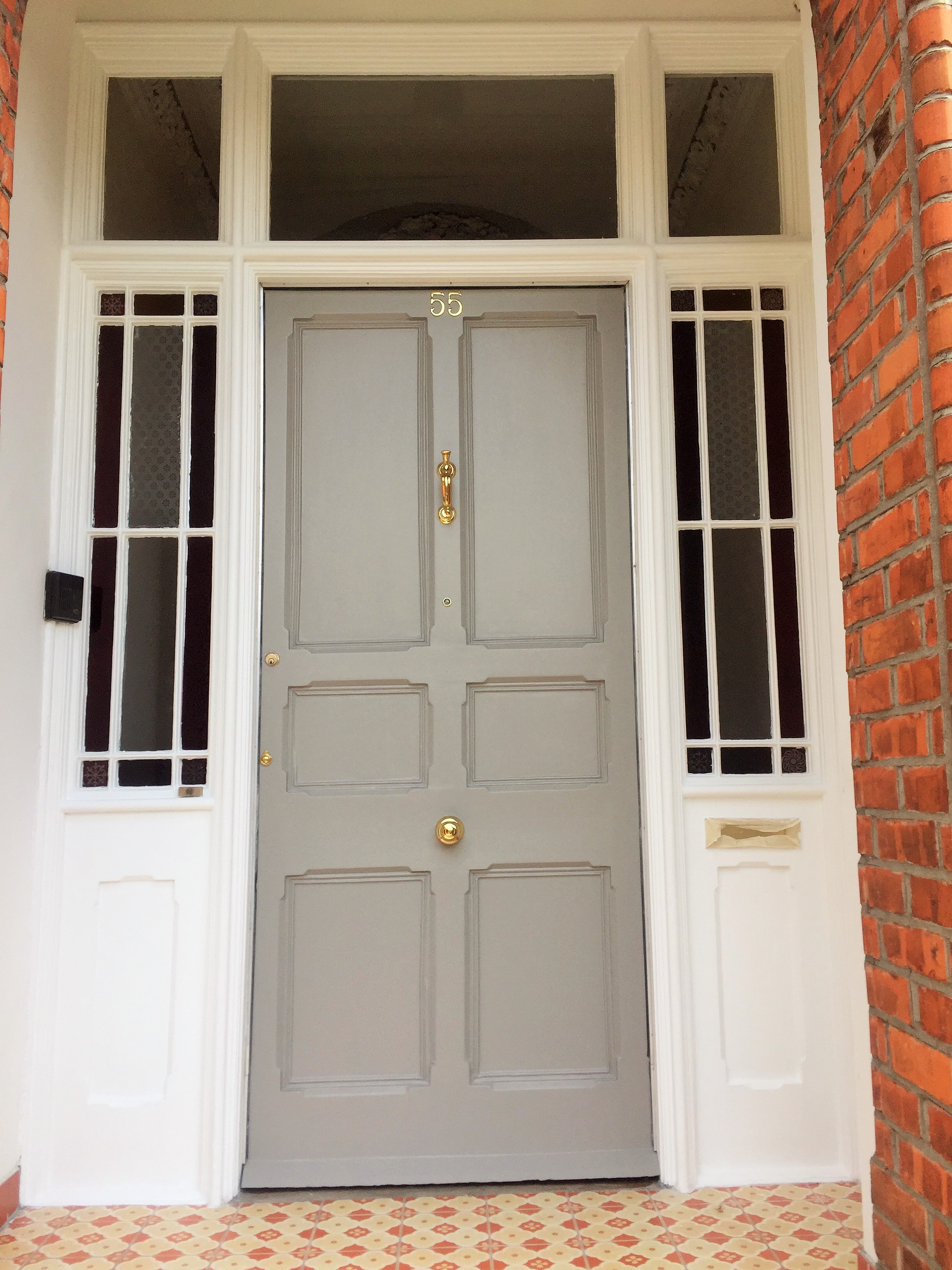 Front door painting and period door restoration by Impressions Painters and Decorators in Dublin