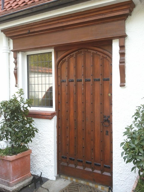 A Tudor style front door restored and stained in a period house in Killiney by Impressions Painters and Decorators