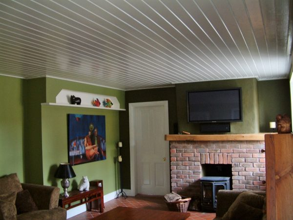 A room we brightened by painting the wooden ceiling by Impressions Painters and Decorators