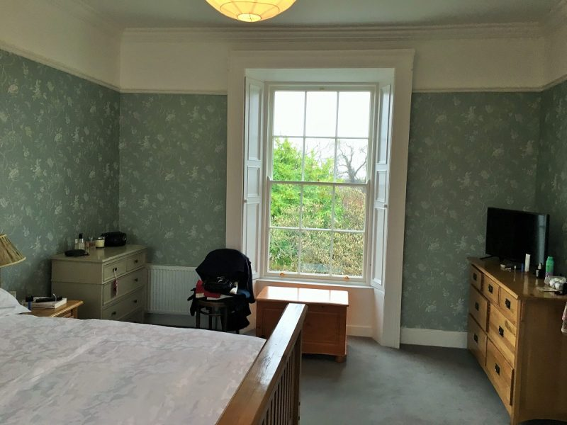 Bedroom wallpapering in a period house restoration by Impressions Painting and Decorating