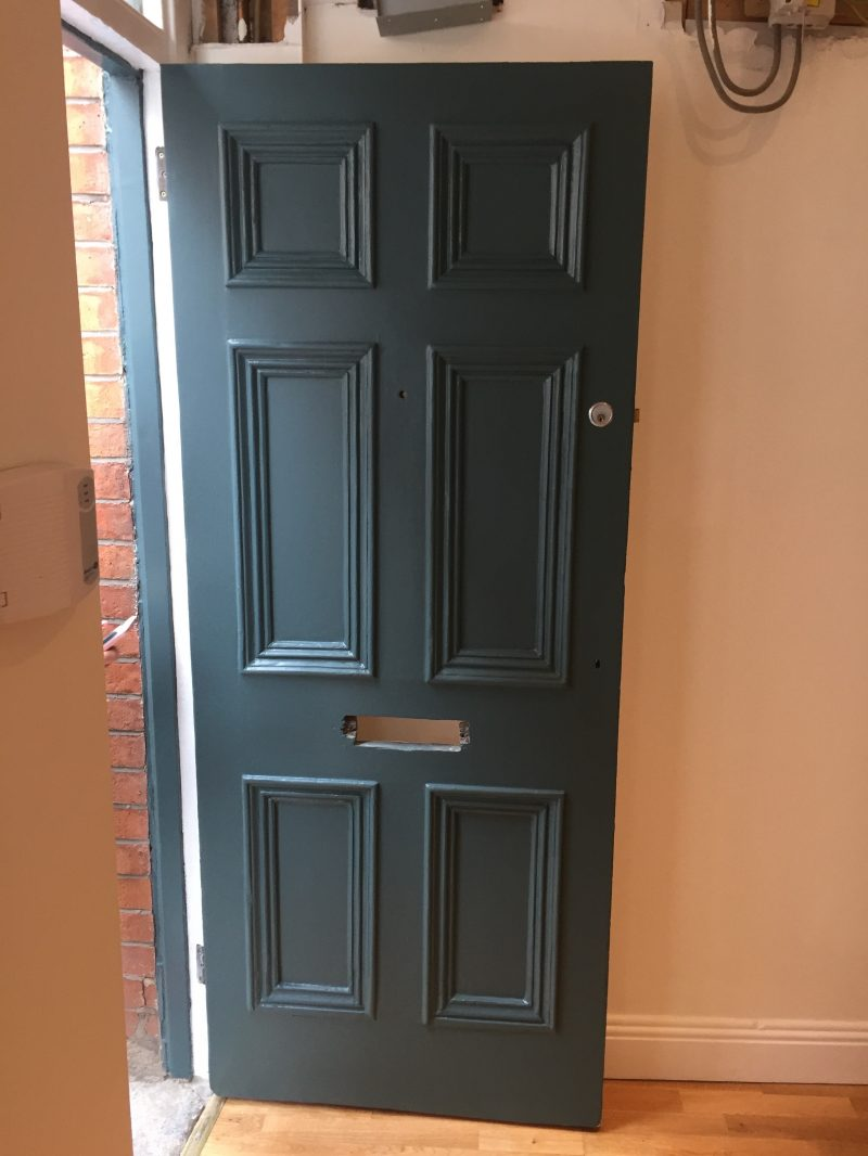 Fully restored door painted and restored by Impressions Painters and Decorators in Dublin 2