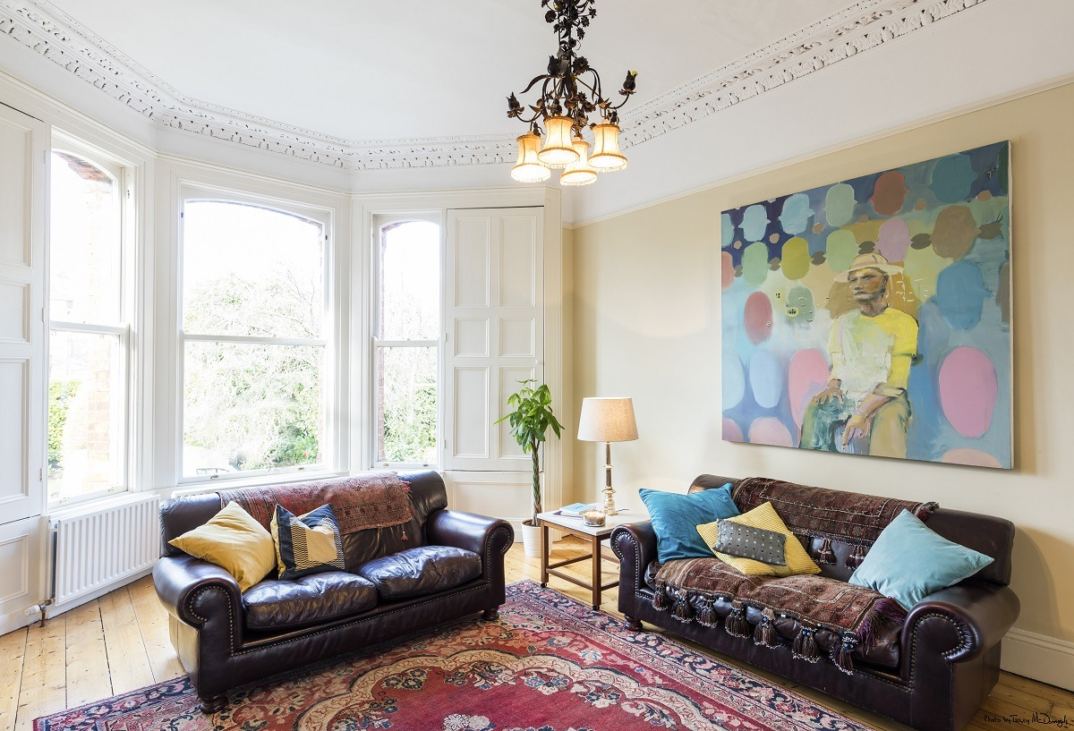 Fully stripped skimmed and restored living room in a period house by Impressions Painting and Decorating in Glenageary