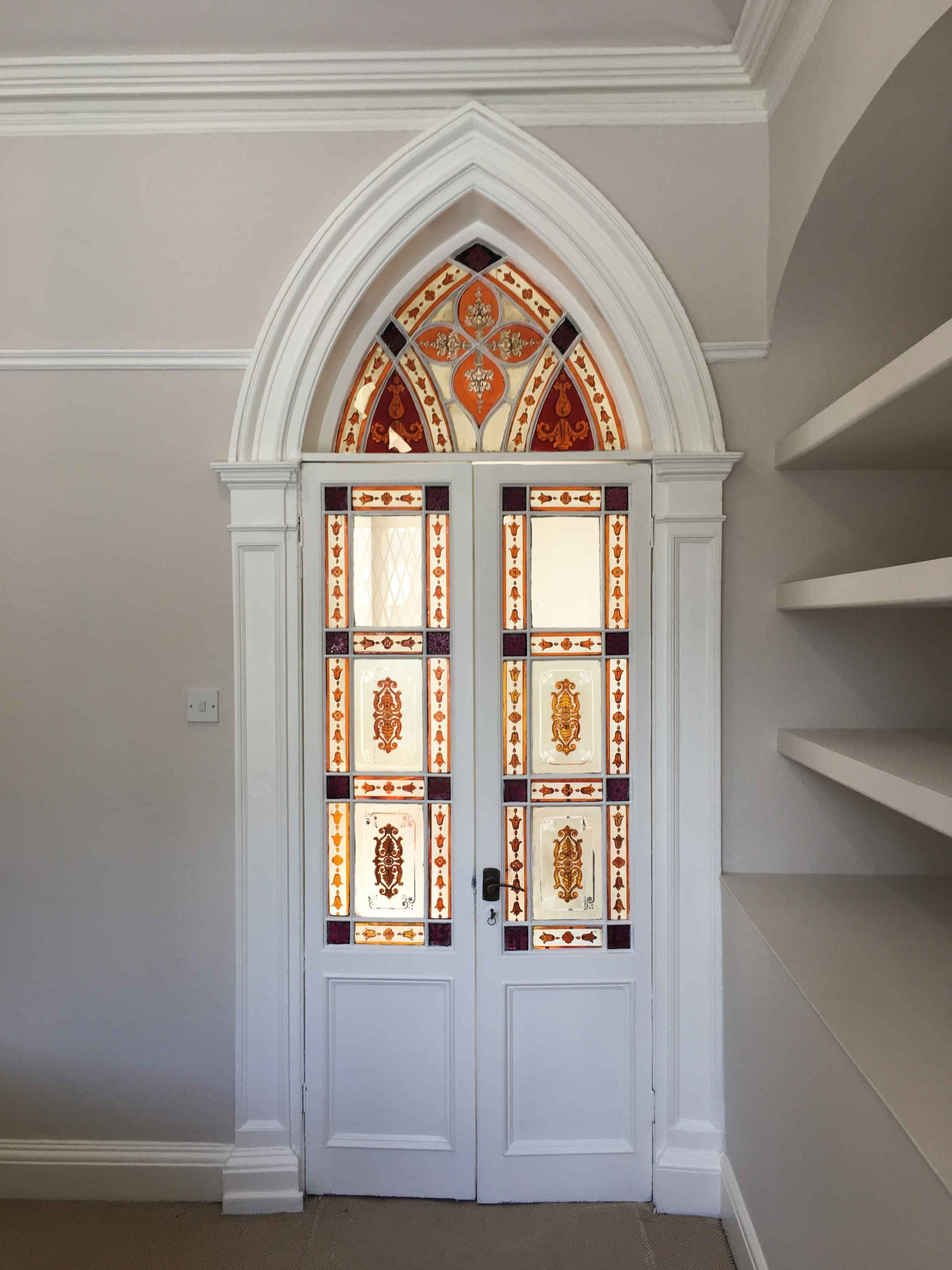 Period interior door with stain glass painted and restored by Impressions Painters and Decorators